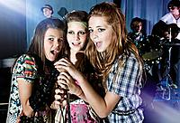 Girls 10_12 singing in band on stage