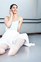 Ballet dancer talking on cell phone