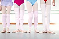 Ballet dancers wearing leg warmers