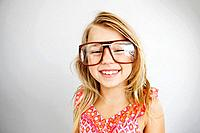 Studio portrait of smiling girl 7_9 wearing big glasses