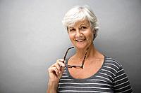 Portrait of smiling senior woman, studio shot