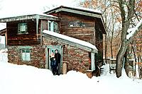 Portrait of family outside rustic house (thumbnail)