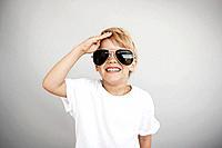 Portrait of blond boy 5_6 wearing sunglasses