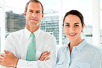 Businessman and businesswoman in office, portrait