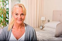 Mature woman in bedroom