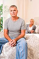 Worried couple in bedroom