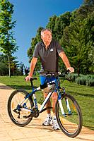 Senior male cyclist with bicycle (thumbnail)