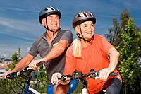 Mature couple on bicycles (thumbnail)
