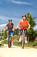 Mature couple cycling together