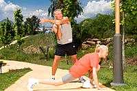 Mature couple stretching before exercise