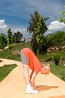 Mature woman runner stretching