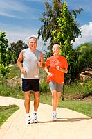 Mature couple jogging together (thumbnail)