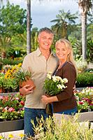 Couple with plants in garden centre (thumbnail)