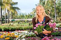 Woman with flowers at garden centre