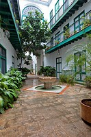 Cuba, Havana  Courtyard of the Casa de los Arabes, an 18th Century Building in Old Havana, in the Rain