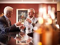 Businessmen drinking together in bar