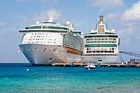 Cruise ship passengers on pier disembarking from Royal Caribbean cruise ships in Cozumel, Mexico in the Caribbean Sea