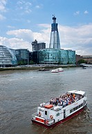 Tourist boat on river Thames with the Shard building in the background  London  UK