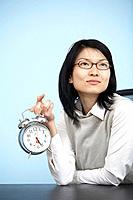 Mid_Adult Businesswoman Holding Alarm Clock
