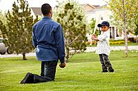Father teaching son to play baseball