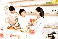 Family preparing meal together in the kitchen
