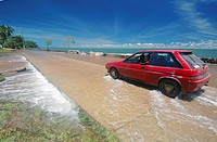 Car moving through king tide inundation of Saibai Island, Torres Strait, Queensland, Australia, 17 Feb 2011  No PR