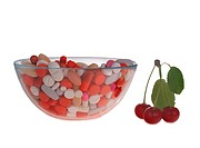 Pills in glass bowl and sour cherries isolated on white Alternatively, pills or - Choose