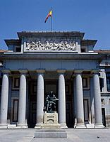 View of Prado Museum. Stone pillars / columns. Ornate building. Statue. Flag