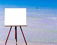 Easel with blank paper outdoors