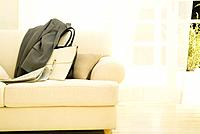 Jacket and purse on a sofa