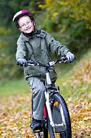 boy is cycling cross_country, autumn
