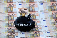 Black piggy bank with Schwarzgeld or dirty money and 50_euro notes