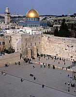 Temple Mount sacred site with Al Aksar Muslim mosque and the gold dome,and the Wailing Wall with Jewish people praying.