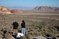 Las Vegas, Nevada - A couple looks over Red Rock Canyon towards the city of Las Vegas in the valley below