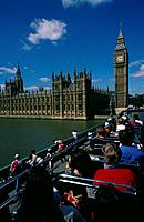 View of Houses of Parliament from open topped bus. Westminster bridge. River Thames. Big Ben. People.