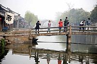 People on bridge, China