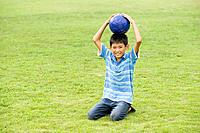Portrait of a boy with soccer ball, Chiba Prefecture, Honshu, Japan