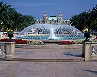 Casino. Large baroque building. Dome. Towers. Formal gardens/ bedding. Dome of water jets. Fountain