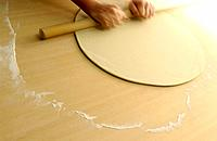 Man making Soba noodles, rolling dough, blurred motion