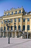 Schonbrunn Palace. Baroque imperial house. Yellow exterior. View of facade. Courtyard.