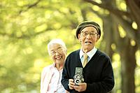 Senior couple with vintage camera