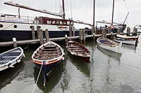 Rowing boats and sailing vessel in the harbour of West-Terschelling. Terschelling, Netherlands