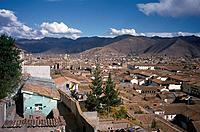 Town in high mountains. View over city roofs