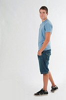 Full-body photograph of a teenage boy standing.