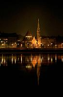 River Danube. Night. Spire of Calvanist church. Reflection in calm water.