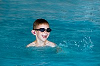 Little boy in a swimming pool