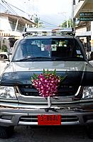 Tong Sala town. Car. Decoration of purple orchid flowers for Chinese New Year. Andaman coast.