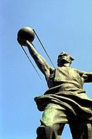 Soviet spaceflight monument. Statue of a steelworker holding the Sputnik satellite. This monument was erected to commemorate the achievements of the S...