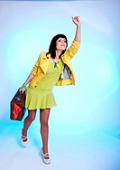 brunette with suitcase waving