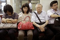Japan, Tokyo, Ginza, Ginza Metro Station, subway, train, car, passengers, commuters, Asian, man, woman, dozing off, nodding, falling asleep, sleeping,